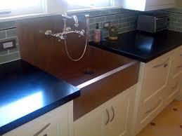 custom copper farmhouse sink with integral backsplash