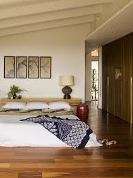 Example of a midcentury modern master orange floor bedroom design in Orange  County