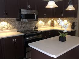 under cabinet kitchen lighting led. Traditional Kitchen Design With Under Cabinet Lighting Using LED Puck Lights And White Also Upholstered Led