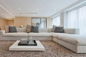coffee table large space white modern living room area with gray rug and coffee table