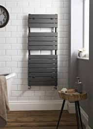 heated bathroom tiles. Bathroom With Subway Tiles And Black Heated Towel Rail : Amazing Rails For Bathrooms