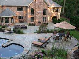 breathtaking pool and dining outdoor living spaces patios finished in bluestone and grey crab orchard saddle