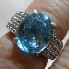 439 27 large cambodian blue zircon a 10 x 12 mm weighing 6 75 cts with 1 05 ct
