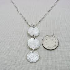 a hand made silver fingerprint necklace made to order from everlasting impressions custommade