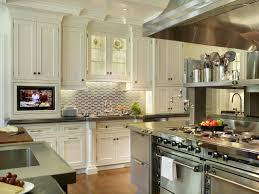 white transitional chef kitchen with stainless range