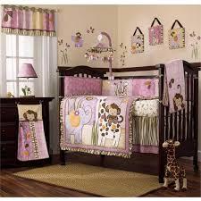 jungle animals themed nursery interior with jungle animal baby girl bedding set and pink animal