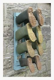image of painted wooden wall mounted welly boot rack