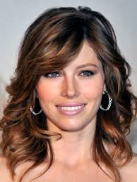 elise neal short brown hairstyle with side swept bangs highlights for dark