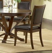 stradford 5 piece cherry round tressel dining set maybe it has a split personality but the stradford 5 pc cherry round tressel dining set manages to be