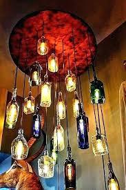 bottle chandelier kit whiskey bottle chandelier salvaged liquor bottle chandelier via so cool looking whisky bottle