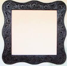 western dark sienna tooled leather frame fl design with serpentine shape hand stitch edge