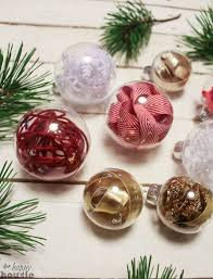 filling clear glass ornaments with ribbon