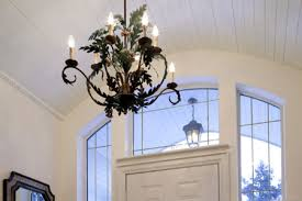 entryway with a chandelier