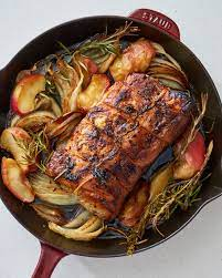 juicy pork roast with apples and onions