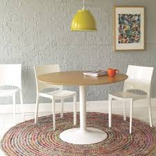 round rugs colored circular dining table stone wall