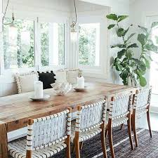 coastal beach house dining room with a wooden picnic table and fig tree beach house style furniture