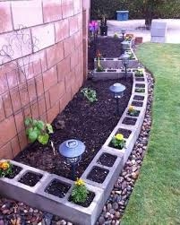 use cinder blocks for edging around a garden flower bed these are the