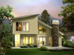 contemporary style two story house built into the earth