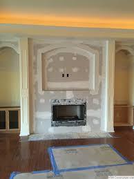 tv hole above fireplace ideas