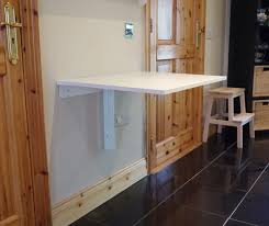 maximizing small spaces for garage laundry room design with wall mounted fold down table painted with white color ideas