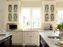 gray kitchen designs. as with other rooms in this home, the kitchen design was inspired by cream, buff, and gray shadings of flagstone landscaping outside. designs