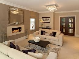 accent wall with brown furniture showing beige fabric sofa and black wooden table on