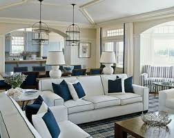 crisp color palette of navy and white creates a traditional hampton beach style living room beach style living room