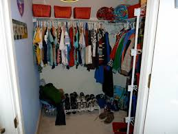very small closet room design with diy pipe wardrobe storage combined with shoe storage and rattan