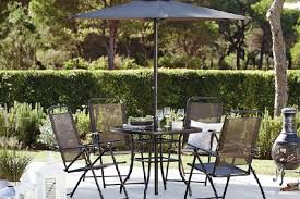 oslo four seater dining set and parasol available from dunelm photo pa
