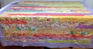 How to Change the Dimensions of a Jelly Roll Race Quilt & How to Create a Bigger Jelly Roll Race Quilt Adamdwight.com