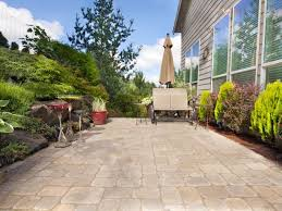 backyard paver patio with garden accessories