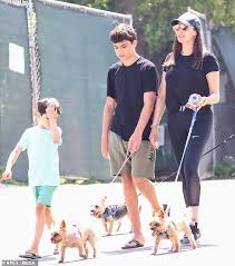 Lauren Silverman is joined by sons Eric and Adam as she walks ...