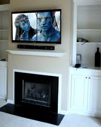 photos of tv installation over fireplace