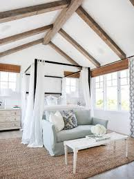 coastal bedroom features lovely seating area