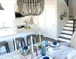 wood beaded chandelier wood beaded chandelier modern farmhouse style kitchen and dining satori design for living