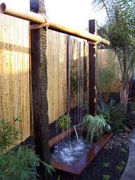 another simple take this waterwall design uses bamboo and simple carved posts for support create a waterscape below or make a disappearing pool