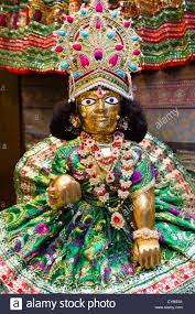 Lord Krishna figurine at a market stall ...