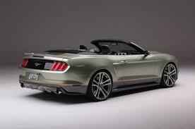 2015 mustang convertible. so you might ask with all this talent readily available at his fingertips and the ability to own build or drive anything he wanted what is parked in 2015 mustang convertible