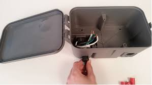 3 feed the power supply wires through the bottom left hole of the enclosure