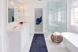 white and blue contemporary bathroom with dark blue overdyed rug gallery