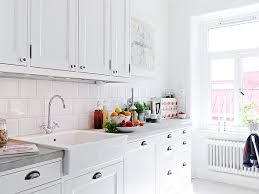 kitchen with white tiles