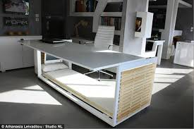bed in office. Ready For A Nap? The Desk Lifts To Reveal Sleep Cabin Below, Complete Bed In Office