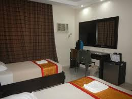 bedroom with tv and desk. Grand Astoria Hotel: TV, Desk, Small Refrigerator, Aircon Bedroom With Tv And Desk