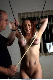Bondage babe clamped and caned