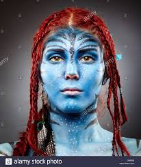 closeup portrait of a model with avatar inspired face painting stock image