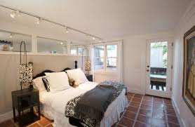 bedroom track lighting. view in gallery perfect way to combine track lighting with a couple of lovely floor lamps bedroom