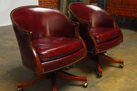gorgeous smooth burdy leather with brass nailhead trim featuring a barrel back form made of solid