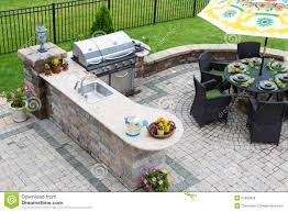Kitchen Patio Outdoor Kitchen And Dining Table On A Paved Patio Stock Photo