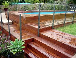 Image Wooden Above Ground Swimming Pool Design With Brick Deck And Glass Fence Don Pedro All You Need To Know About Above Ground Pool with Pictures