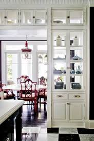 the double sided gl cabinets make a great room divider good for display lets red chairsred dining